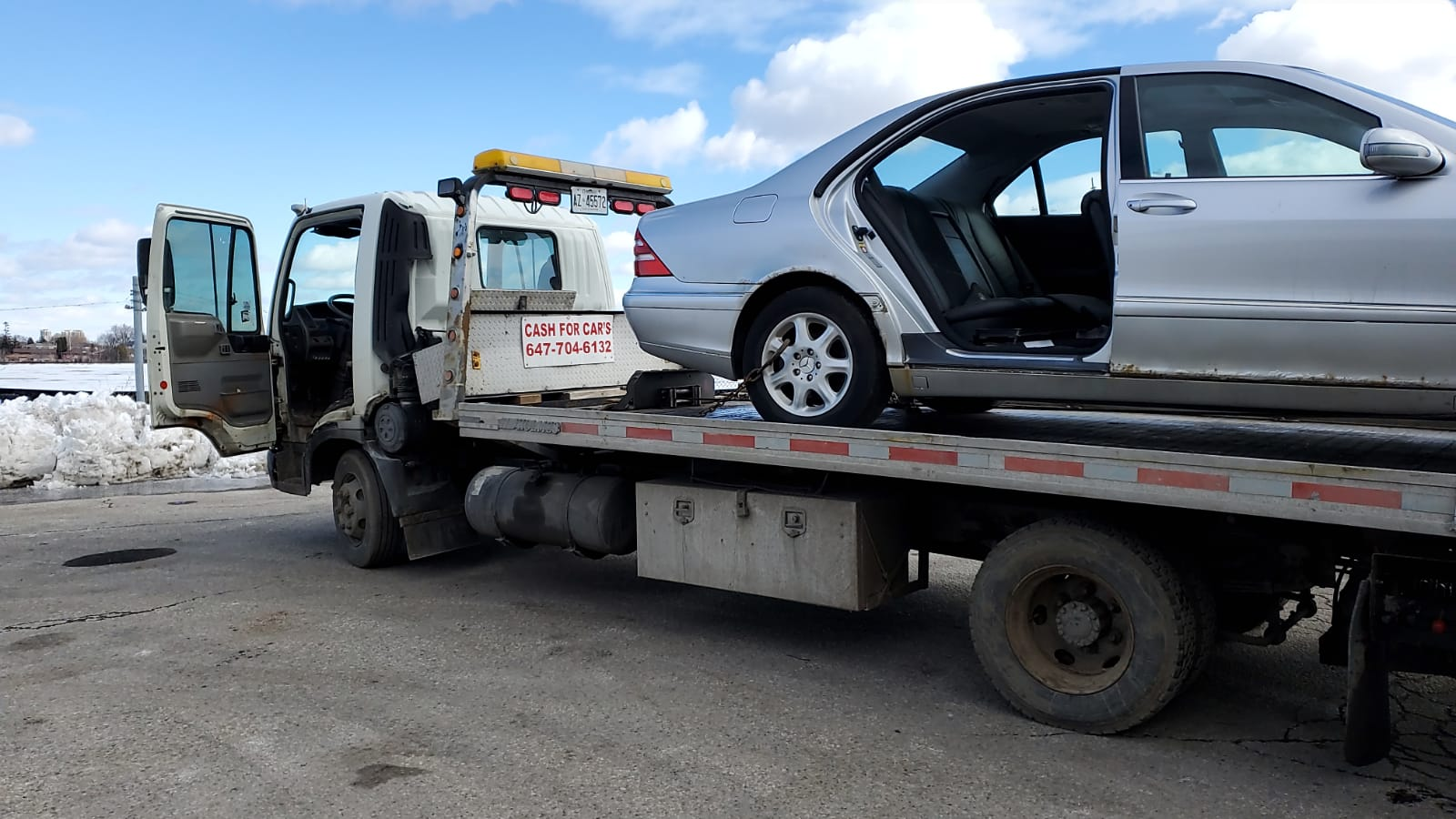 how much does a flatbed tow truck cost
